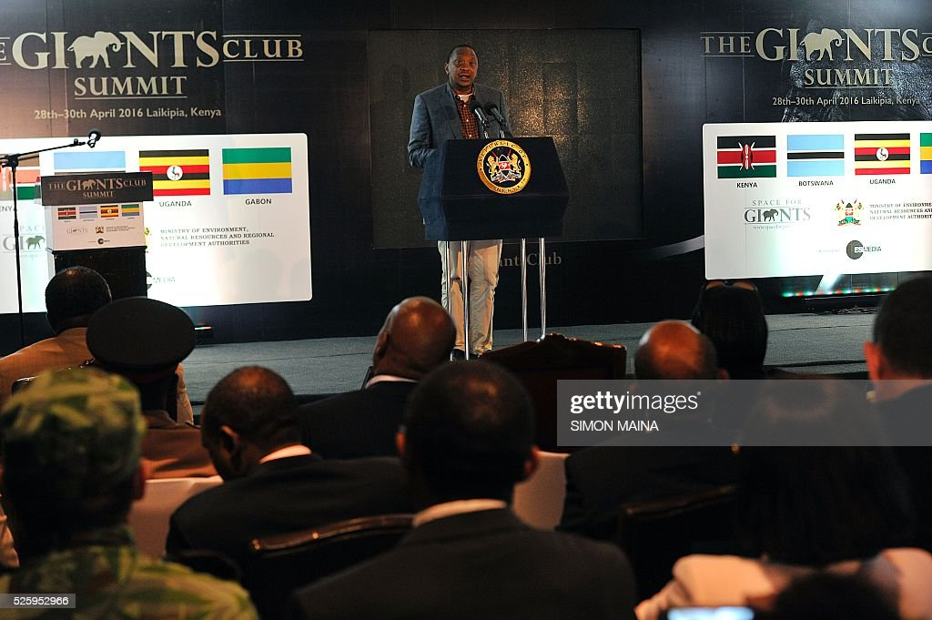 Kenya's President Uhuru Kenyatta address delegates attending the opening session of the anti-poaching Giants Club Summit meeting in Nanyuki, Laikipia county on April 29, 2016. From anti-poaching commandos deployed by helicopter to boosting court prosecutions: Kenya is hosting a summit on how to end ivory trafficking and prevent the extinction of elephants in the wild. Kenyan President Uhuru Kenyatta is heading the meeting which groups African heads of state and conservationists in the central town of Nanyuki to boost awareness of the threat of poaching. MAINA
