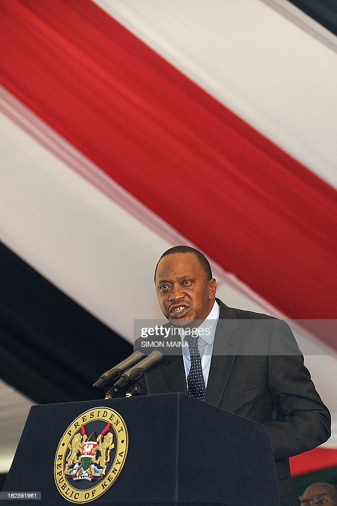 Kenya's President Uhuru Kenyatta (L) addresses a special inter-religious prayer service for the people killed and injured in the recent Westgate shopping mall attack in the capital Nairobi, on October 1, 2013. Until the Nairobi mall carnage, Uhuru Kenyatta was a beleaguered and divisive president. But his own bereavement and new clothes as commander-in-chief have earned him fresh support and, some say, a 'get out of jail free card' for the International Criminal Court. The deadly September 21 raid on the Westgate mall brings new challenges to the government, which now has to explain why it failed to act on repeated warnings and find ways to thwart future attacks.