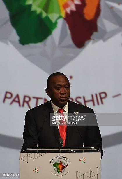 Kenya's President Uhuru Kenyatta addresses delegates during The IndiaAfrica Summit in New Delhi on October 29 2015 India's Prime Minister Narendra...