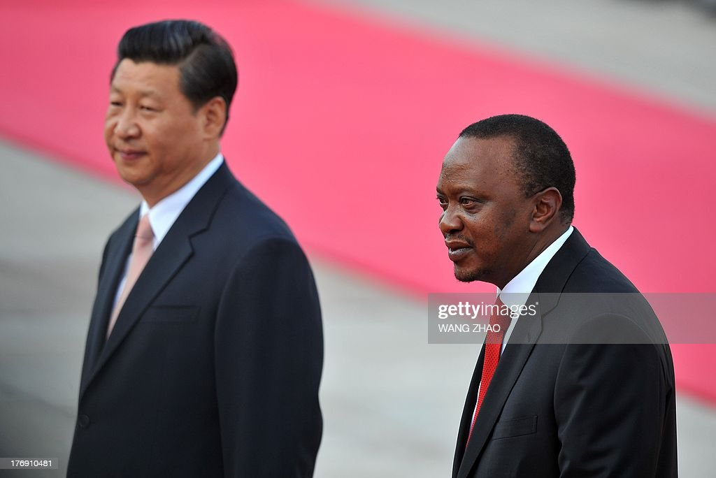 Kenya's President Uhuru Kenyatta (R) and Chinese President Xi Jinping (L) inspect Chinese honour guards during a welcoming ceremony outside the Great Hall of the People in Beijing on August 19, 2013. Uhuru Kenyatta is on a visit to China from August 18 to 23.