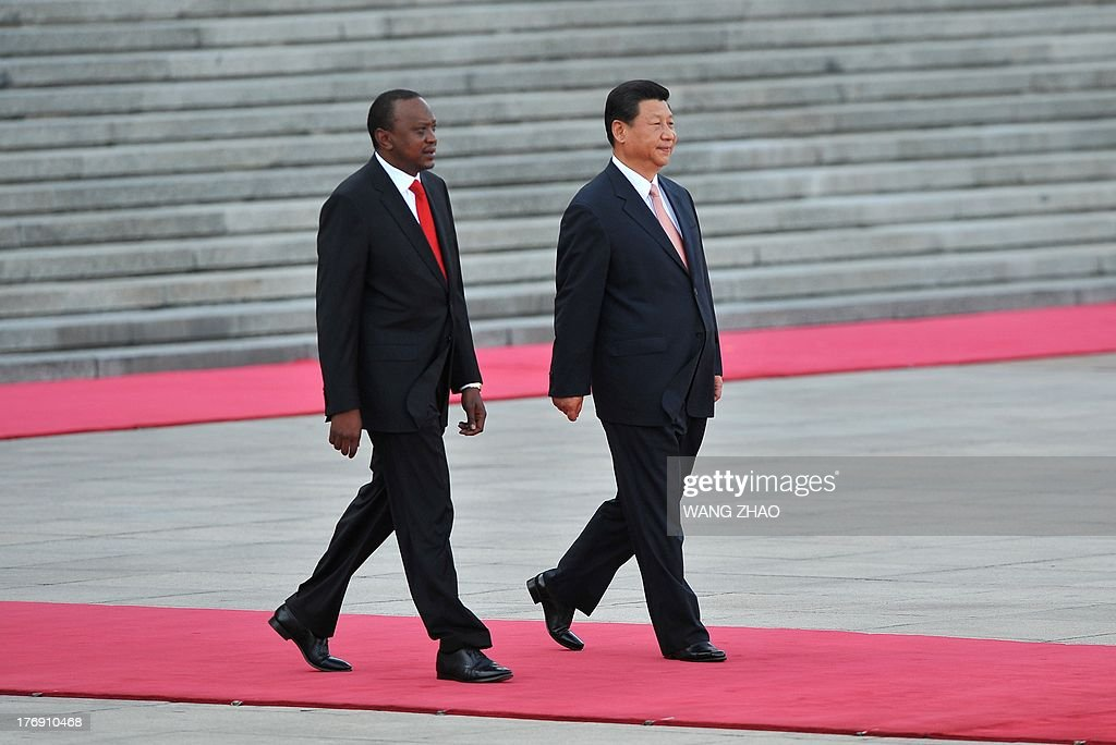 Kenya's President Uhuru Kenyatta (L) and Chinese President Xi Jinping (R) prepare to inspect Chinese honour guards during a welcoming ceremony outside the Great Hall of the People in Beijing on August 19, 2013. Uhuru Kenyatta is on a visit to China from August 18 to 23.