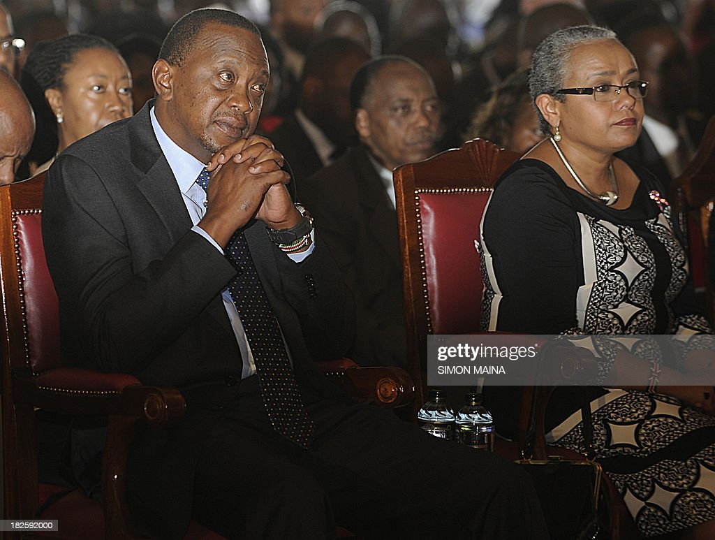 Kenya's President Uhuru Kenyatta (L) and First Lady Margaret Kenyatta attend a special inter-religious prayer service for the people killed and injured in the recent Westgate shopping mall attack in the capital Nairobi, on October 1, 2013. Until the Nairobi mall carnage, Uhuru Kenyatta was a beleaguered and divisive president. But his own bereavement and new clothes as commander-in-chief have earned him fresh support and, some say, a 'get out of jail free card' for the International Criminal Court. The deadly September 21 raid on the Westgate mall brings new challenges to the government, which now has to explain why it failed to act on repeated warnings and find ways to thwart future attacks. AFP PHOTO / SIMON MAINA