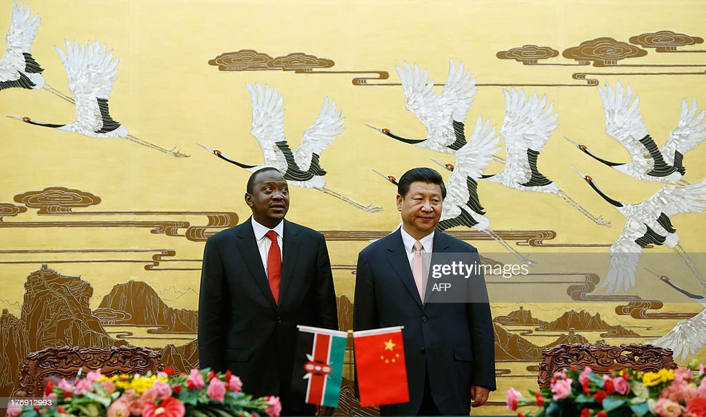 Kenya's President Uhuru Kenyatta (L) and his Chinese counterpart Xi Jinping (R) attend a signing ceremony at the Great Hall of the People in Beijing on August 19, 2013. Kenyatta, who faces trial on charges of crimes against humanity, was welcomed to China on August 19 with a 21-gun salute and a meeting with President Xi Jinping.