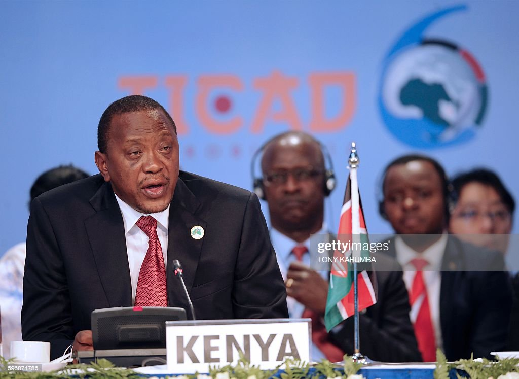 Kenya's President Uhuru Kenyatta delivers his closing remarks at the end of the sixth Tokyo International Conference on African Development in...