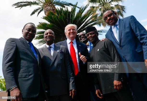Kenya's President Uhuru Kenyatta Guinea's President Alpha Conde US President Donald Trump African Development Bank President Akinwumi Adesina Vice...