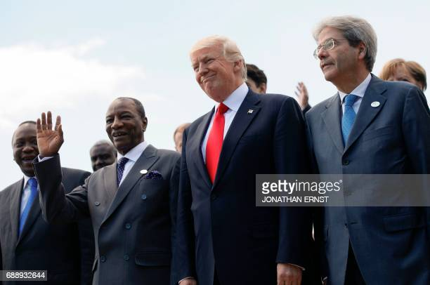 Kenya's President Uhuru Kenyatta Guinea's President Alpha Conde US President Donald Trump and Italian Prime Minister Paolo Gentiloni pose during a...