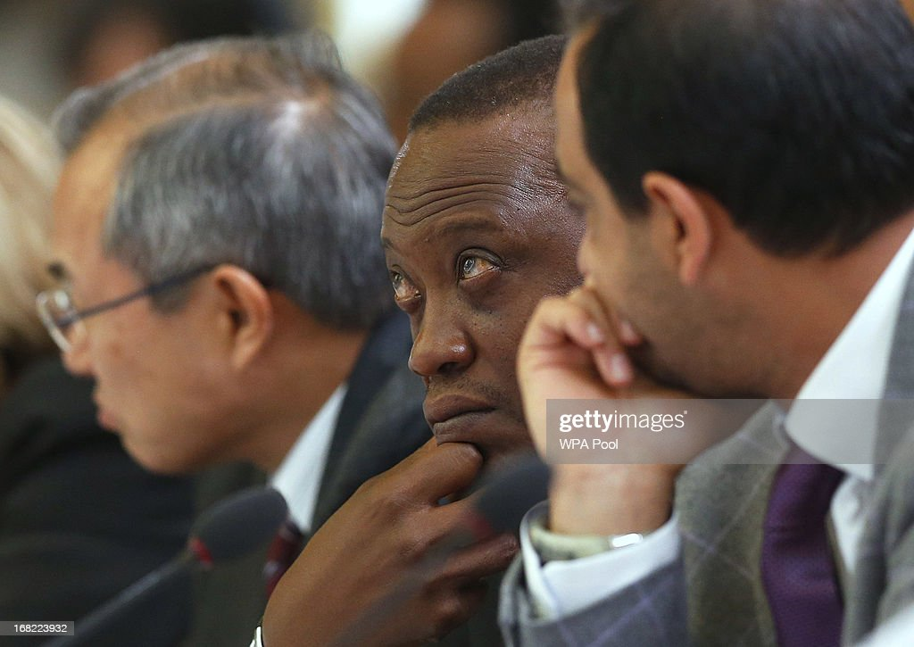 Kenya's President <a gi-track='captionPersonalityLinkClicked' href=/galleries/search?phrase=Uhuru+Kenyatta&family=editorial&specificpeople=2149190 ng-click='$event.stopPropagation()'>Uhuru Kenyatta</a> (C) listens as Prime Minister David Cameron opens during the Somali conference, on May 7, 2013 in London, England. The international conference aims to help rebuild the east African country after more more than two decades of conflict.