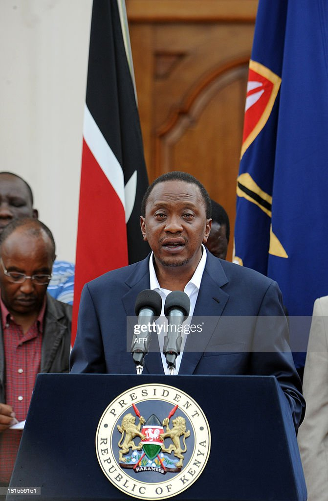 Kenya's President Uhuru Kenyatta makes his statement to the nation at the State House in Nairobi on September 22, 2013, following the overwhelming numbers of casualties from the Westgate mall shooting in the Kenyan capital. Kenyan President Uhuru Kenyatta said Sunday a nephew and his fiancee were among the 59 people confirmed killed in an ongoing siege in an upmarket shopping mall by Somali militants. AFP PHOTO / JOHN MUCHUCHA