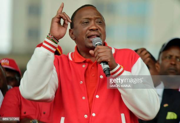 Kenya's President Uhuru Kenyatta of the Jubilee Party addresses his supporters on May 29 2017 in Nairobi after receiving the clearance certificate of...