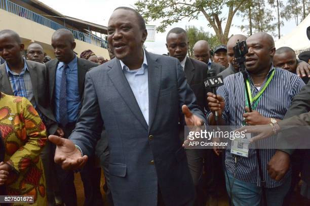 Kenya's President Uhuru Kenyatta speaks to the media after voting at a polling station during the August 8 2017 presidential election in Gatundu...