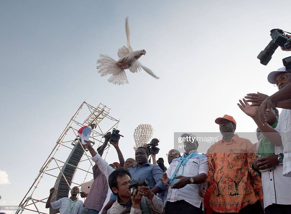 Kenya's Prime Minister and presidential candidate Raila Odinga (3rd L) releases a dove along with his running mate Kalonzo Musyoka (4th L) at a rally in Nyayo Stadium in Nairobi on March 2, 2013 on the last day of campaigning, 48 hours ahead of presidential, gubernatorial and senatorial elections. AFP PHOTO / Will Boase