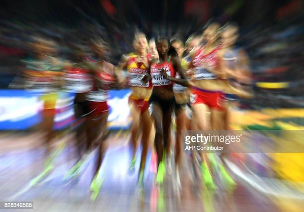 Kenya's Purity Cherotich Kirui competes with fellow athletes in the women's 3000m steeplechase athletics event at the 2017 IAAF World Championships...