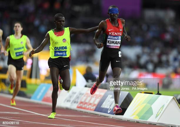 Kenya's Samuel Mushai Kimani and guide James Boit win the Men's 1500m T11 Final during day eight of the 2017 World Para Athletics Championships at...