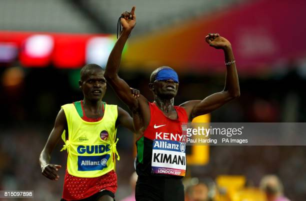 Kenya's Samwel Mushai Kimani and guide James Boit winning the Men's 5000m T11 Final during day two of the 2017 World Para Athletics Championships at...