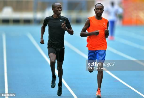 Kenya's steeplechasers Ezekiel Kemboi four time world champion and Jairus Birech 2016 Diamond league champion run at a training facility in Nairobi...