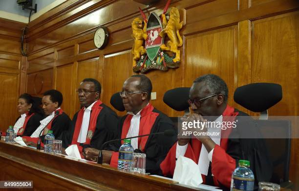 Kenya's Supreme Court judges sit together before delivering a detailed ruling laying out their reasons for annulling August 8 2017 presidential...
