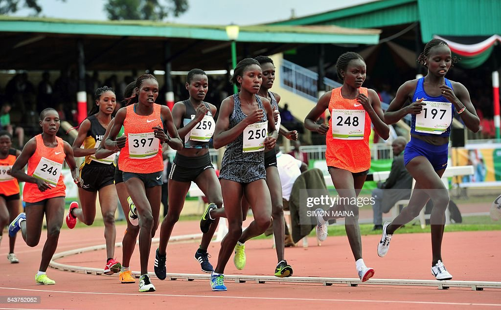 Kenya's Vivian Jepkemei Cheruiyot (197) leads the 10,000 meters women final to win on June 30, 2016 in Eldoret, during the trials for Rio Olympics games. / AFP / SIMON