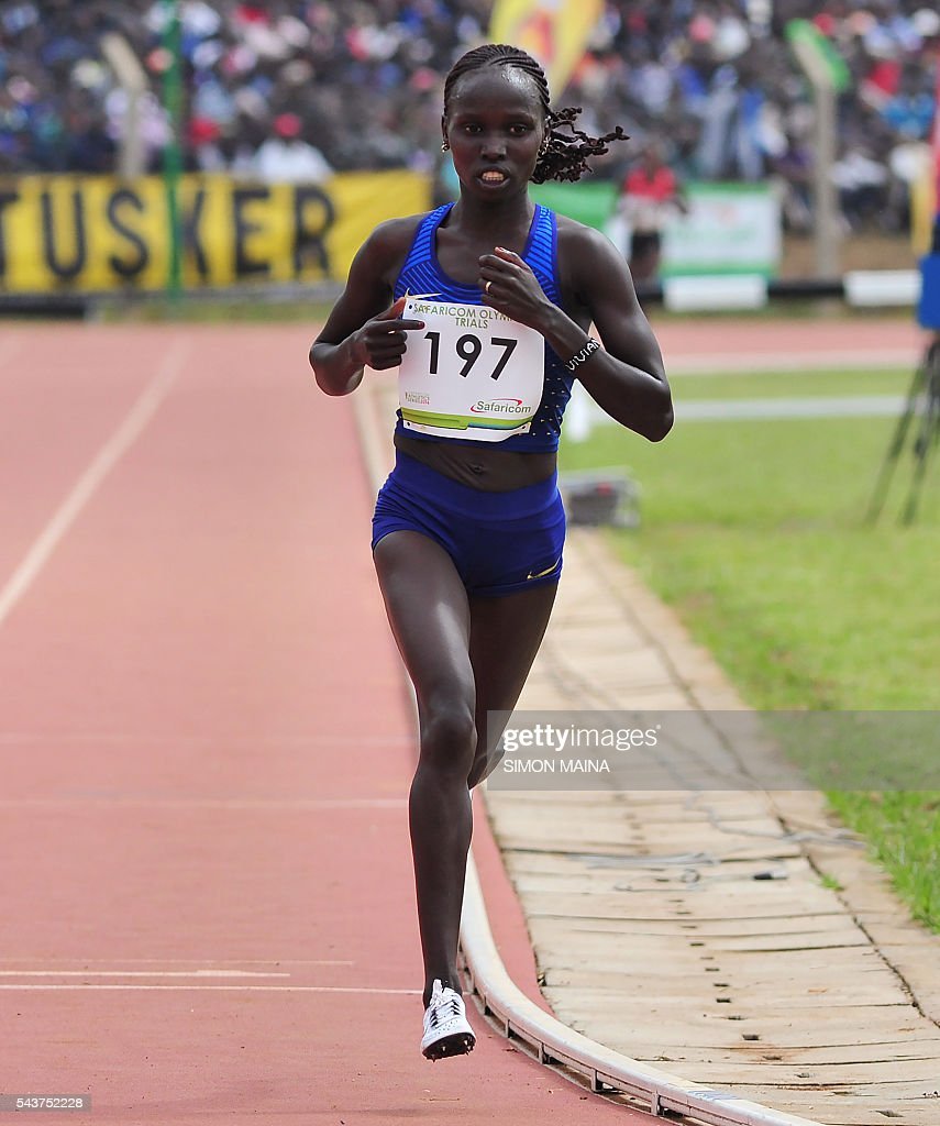 Kenya's Vivian Jepkemei Cheruiyot (197) leads the 10,000 meters women final to win on June 30, 2016 in Eldoret, during the trials for Rio Olympics games. MAINA