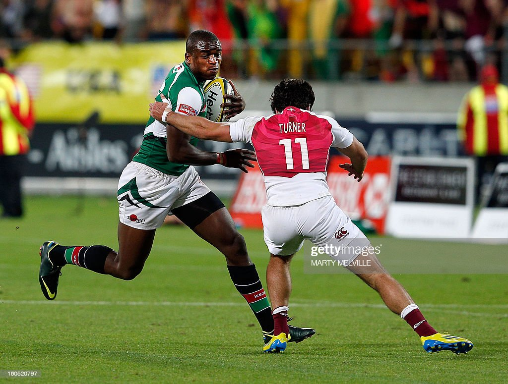 Kenya's Willy Ambaka (L) is tackled by England's Mat Turner during the cup final at the Westpac Stadium on day two of the fourth leg of the IRB Rugby Sevens World Series in Wellington on February 2, 2013. AFP PHOTO / Marty MELVILLE