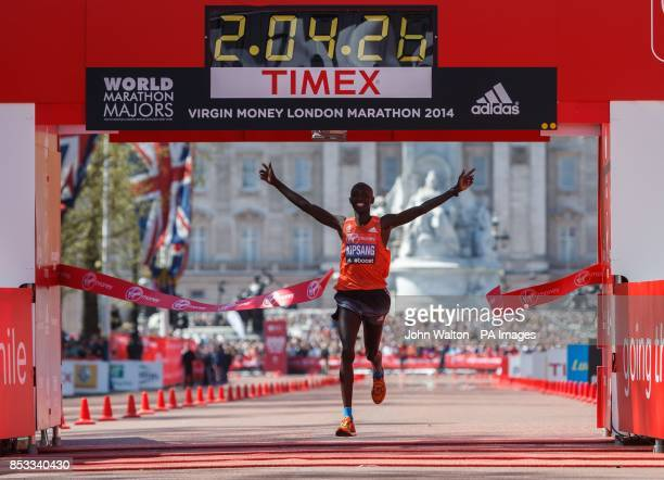Kenya's Wilson Kipsang celebrates winning as he crosses the finish line of the Virgin Money London Marathon on the Mall London