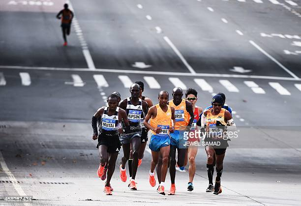 Kenya's Wilson Kipsang runs along with other participants in the New York City Marathon on November 2 2014 Kipsang won the New York City Marathon...
