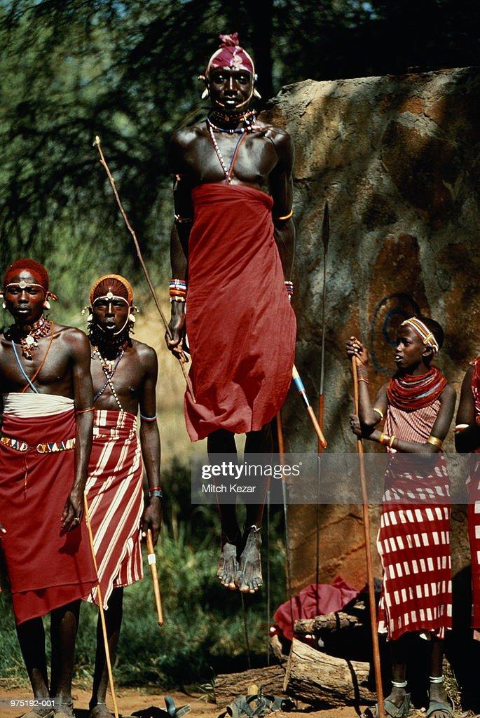 Kenya,Samburu tribe,man leaping in air during tribal dance : Stock Photo