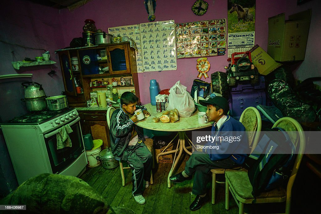 Kenyi Barja, left, and his brother eat breakfast before school in the town of La Oroya, Peru, on Wednesday, March 20, 2013. Most of La Oroyaís children suffer elevated lead levels, according to the Peruvian government. The question of responsibility for lead pollution in La Oroya is at the center of high-stakes clash between Peru and U.S. billionaire Ira Rennert, who owned Doe Run Peru for more than a decade through Renco Group Inc., a metals, mining and industrial conglomerate based in New York that has said it is not responsible for the childrenís ills.Photographer: Meridith Kohut/Bloomberg via Getty Images