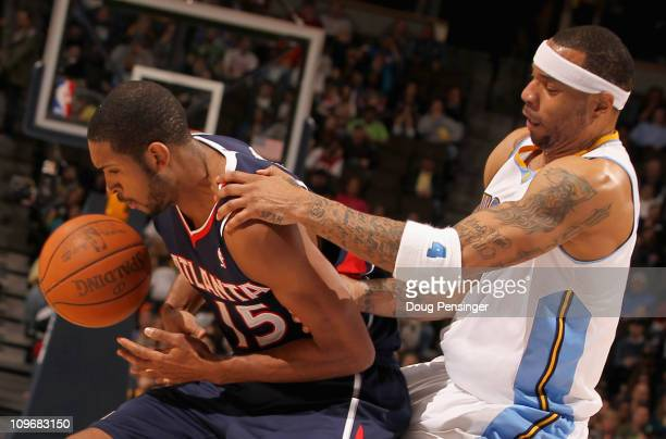 Kenyon Martin of the Denver Nuggets battles with Al Horford of the Atlanta Hawks for control of the ball during NBA action at the Pepsi Center on...