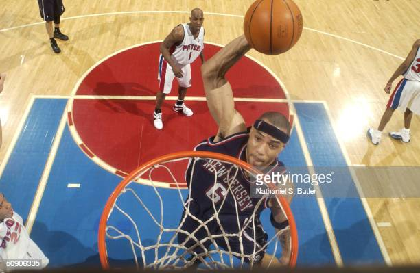 Kenyon Martin of the New Jersey Nets dunks against the Detroit Pistons in Game seven of the Eastern Conference Semifinals during the 2004 NBA...