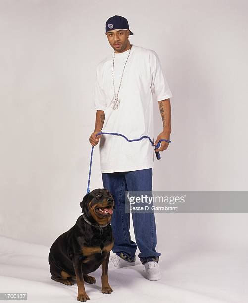 Kenyon Martin of the New Jersey Nets poses for a studio portrait with his dog on December 1 2001 in New Jersey NOTE TO USER User expressly...