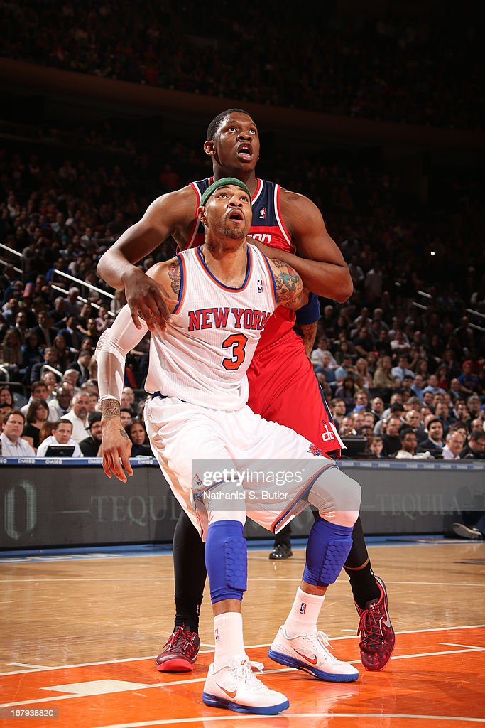 <a gi-track='captionPersonalityLinkClicked' href=/galleries/search?phrase=Kenyon+Martin&family=editorial&specificpeople=201522 ng-click='$event.stopPropagation()'>Kenyon Martin</a> #3 of the New York Knicks battles for positioning against <a gi-track='captionPersonalityLinkClicked' href=/galleries/search?phrase=Kevin+Seraphin&family=editorial&specificpeople=6474998 ng-click='$event.stopPropagation()'>Kevin Seraphin</a> #13 of the Washington Wizards on April 9, 2013 at Madison Square Garden in New York City.