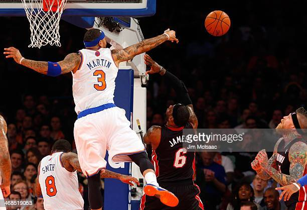 Kenyon Martin of the New York Knicks blocks a shot against LeBron James of the Miami Heat at Madison Square Garden on February 1 2014 in New York...