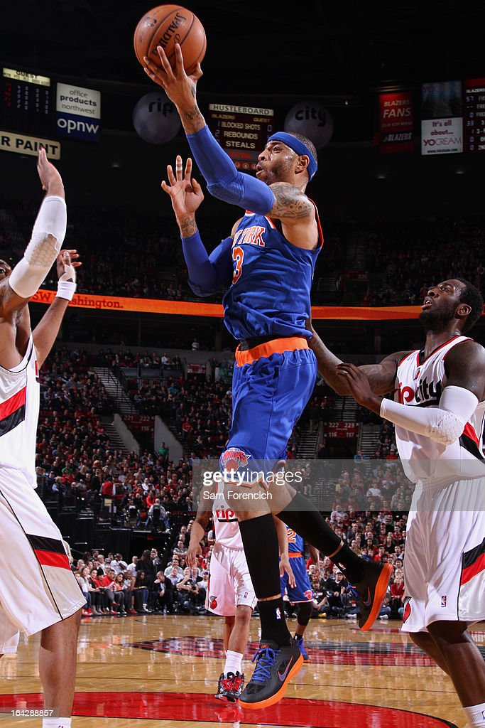 <a gi-track='captionPersonalityLinkClicked' href=/galleries/search?phrase=Kenyon+Martin&family=editorial&specificpeople=201522 ng-click='$event.stopPropagation()'>Kenyon Martin</a> #3 of the New York Knicks drives to the basket against the Portland Trail Blazers on March 14, 2013 at the Rose Garden Arena in Portland, Oregon.
