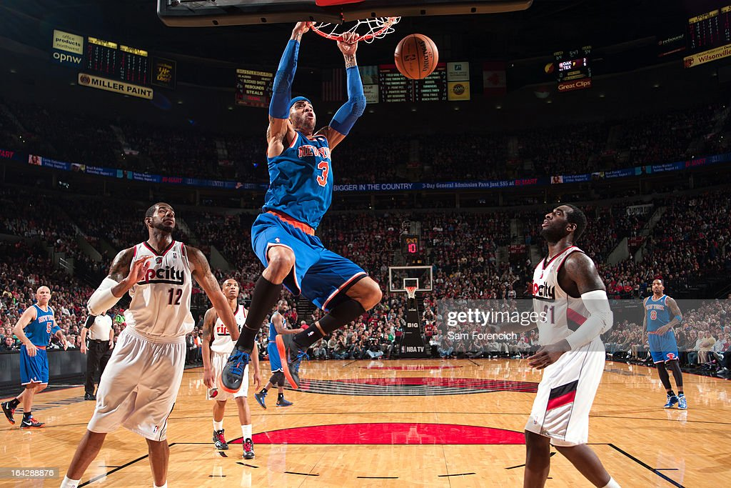 <a gi-track='captionPersonalityLinkClicked' href=/galleries/search?phrase=Kenyon+Martin&family=editorial&specificpeople=201522 ng-click='$event.stopPropagation()'>Kenyon Martin</a> #3 of the New York Knicks dunks the ball against the Portland Trail Blazers on March 14, 2013 at the Rose Garden Arena in Portland, Oregon.