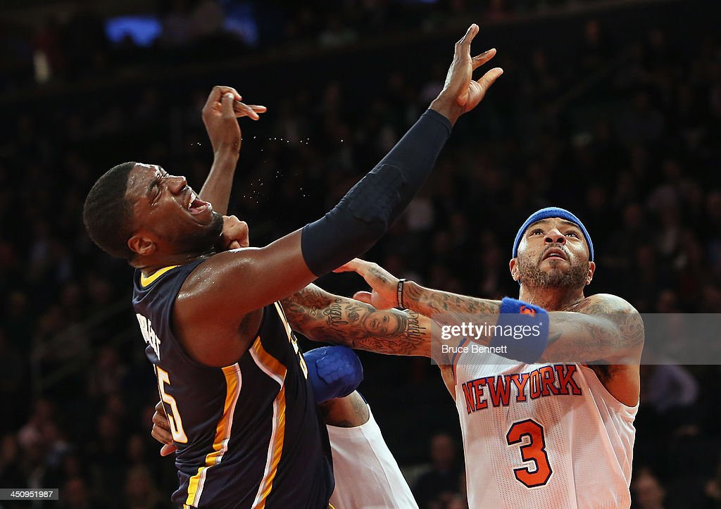 Kenyon Martin #3 of the New York Knicks fouls Roy Hibbert #55 of the Indiana Pacers in the third quarter at Madison Square Garden on November 20, 2013 in New York City.