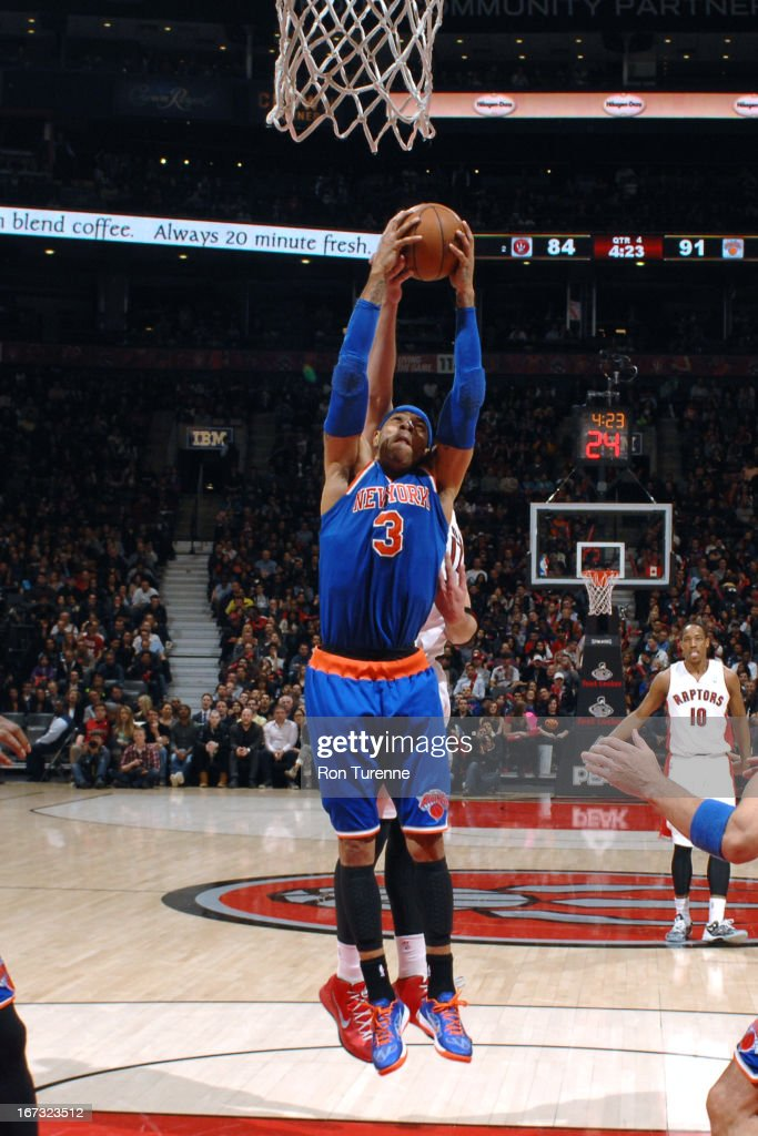 <a gi-track='captionPersonalityLinkClicked' href=/galleries/search?phrase=Kenyon+Martin&family=editorial&specificpeople=201522 ng-click='$event.stopPropagation()'>Kenyon Martin</a> #3 of the New York Knicks grabs a rebound against the Toronto Raptors on March 22, 2013 at the Air Canada Centre in Toronto, Ontario, Canada.
