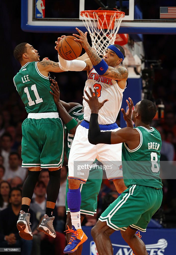 Kenyon Martin #3 of the New York Knicks grabs the rebound before Courtney Lee #11 and Jeff Green #8 of the Boston Celtics during Game One of the Eastern Conference Quarterfinals of the 2013 NBA Playoffs on April 20, 2013 at Madison Square Garden in New York City. The New York Knicks defeated the Boston Celtics 85-78.