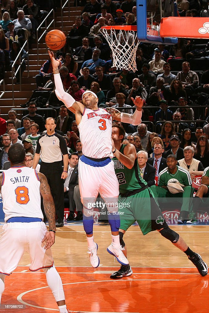 <a gi-track='captionPersonalityLinkClicked' href=/galleries/search?phrase=Kenyon+Martin&family=editorial&specificpeople=201522 ng-click='$event.stopPropagation()'>Kenyon Martin</a> #3 of the New York Knicks grabs the rebound in mid-air against the Boston Celtics on March 31, 2013 at Madison Square Garden in New York City.