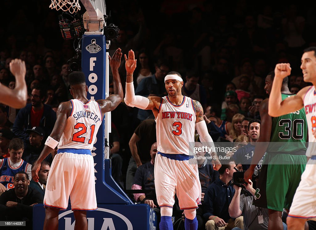 Kenyon Martin #3 of the New York Knicks high-fives teammate Iman Shumpert #21 during a game against the Boston Celtics on March 31, 2013 at Madison Square Garden in New York City.