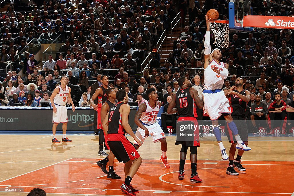<a gi-track='captionPersonalityLinkClicked' href=/galleries/search?phrase=Kenyon+Martin&family=editorial&specificpeople=201522 ng-click='$event.stopPropagation()'>Kenyon Martin</a> #3 of the New York Knicks lays one in while playing in a game against the Toronto Raptors on March 23, 2013 at Madison Square Garden in New York City.