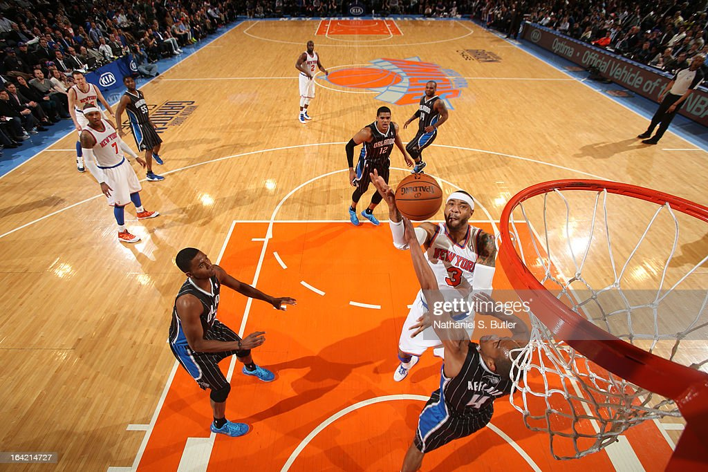 <a gi-track='captionPersonalityLinkClicked' href=/galleries/search?phrase=Kenyon+Martin&family=editorial&specificpeople=201522 ng-click='$event.stopPropagation()'>Kenyon Martin</a> #3 of the New York Knicks shoots against <a gi-track='captionPersonalityLinkClicked' href=/galleries/search?phrase=Arron+Afflalo&family=editorial&specificpeople=640861 ng-click='$event.stopPropagation()'>Arron Afflalo</a> #4 of the Orlando Magic on March 20, 2013 at Madison Square Garden in New York City.
