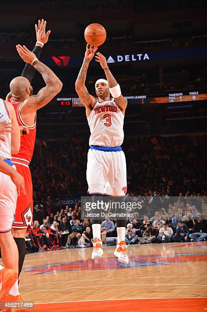 Kenyon Martin of the New York Knicks shoots against the Chicago Bulls during the game on December 11 2013 at Madison Square Garden in New York City...