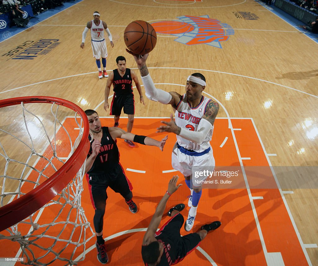 <a gi-track='captionPersonalityLinkClicked' href=/galleries/search?phrase=Kenyon+Martin&family=editorial&specificpeople=201522 ng-click='$event.stopPropagation()'>Kenyon Martin</a> #3 of the New York Knicks shoots while playing in a game against the Toronto Raptors on March 23, 2013 at Madison Square Garden in New York City.