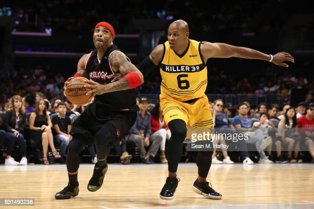 Kenyon Martin of the Trilogy drives to the hoop against Mo Evans of the Killer 3s during week eight of the BIG3 three on three basketball league at...
