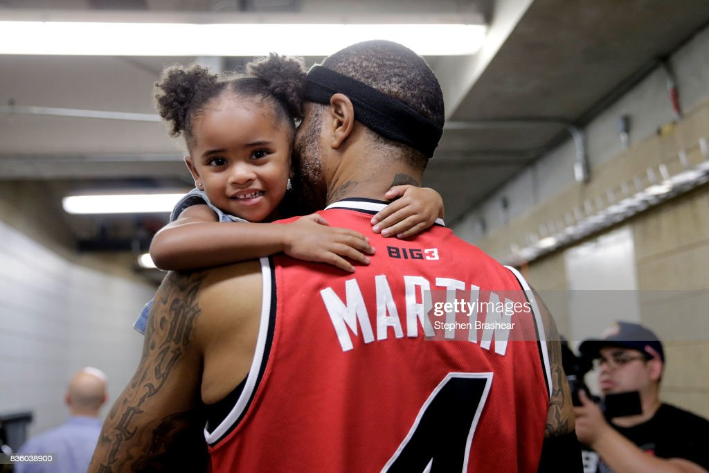 Kenyon Martin #4 of the Trilogy holds his daughter after winning the semi finals against the Ghost Ballers in week nine of the BIG3 three-on-three basketball league at KeyArena on August 20, 2017 in Seattle, Washington.