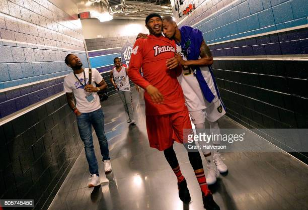 Kenyon Martin of Trilogy and Rashard Lewis of the 3 Headed Monsters walk off of the court together after their game during week two of the BIG3 three...