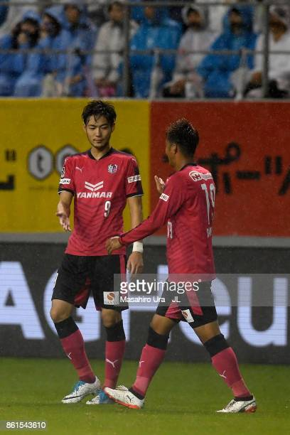 Kenyu Sugimoto and Ryuji Sawakami of Cerezo Osaka celebrate their 21 victory in the JLeague J1 match between Sagan Tosu and Cerezo Osaka at Best...