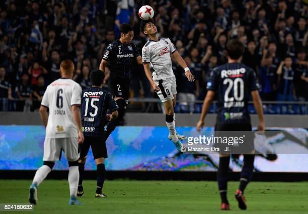 Kenyu Sugimoto of Cerezo Osaka and Genta Miura of Gamba Osaka compete for the ball during the JLeague J1 match between Gamba Osaka and Cerezo Osaka...