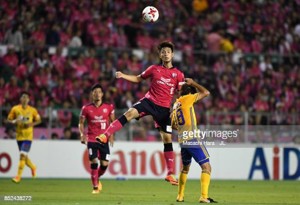 Kenyu Sugimoto of Cerezo Osaka and Hirotaka Mita of Vegalta Sendai compete for the ball during the JLeague J1 match between Cerezo Osaka and Vegalta...