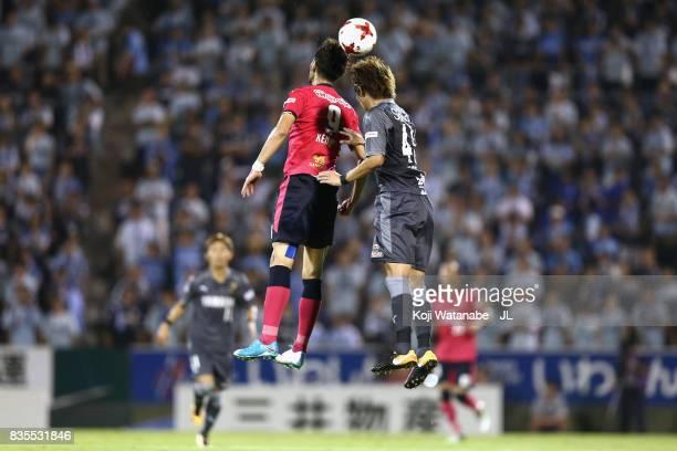 Kenyu Sugimoto of Cerezo Osaka and Shohei Takahashi of Jubilo Iwata compete for the ball during the JLeague J1 match between Jubilo Iwata and Cerezo...